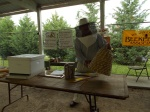 Herb Lester shows 2nd graders how the North American Settlers kept Black German Bees in Skeps
